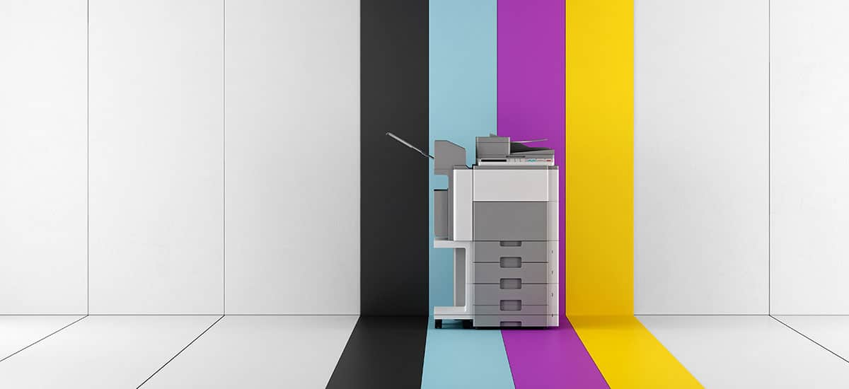 copier machine with printer colors in the background.