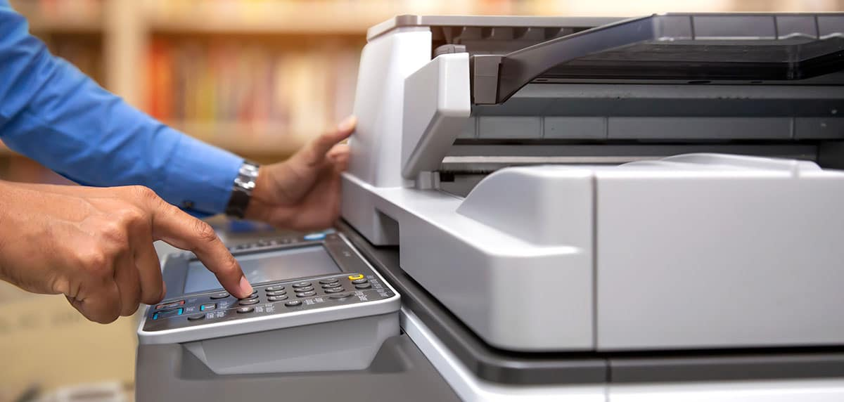business owner operating office copier machine